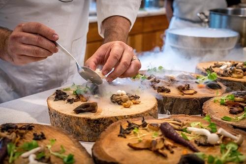 chef-preparing-vegetable-dish-on-tree-slab